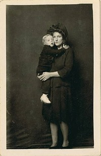 untitled [woman in hat and coat holding toddler in white shoes] by mike disfarmer